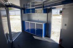 Interior V-nose snowmobile trailer cabinets.