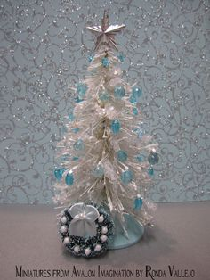 Miniature Dollhouse Sparkly Holiday Christmas tree in White and Aqua Turquoise with icicles and matching Wreath.  via Etsy.