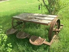 Picnic table with wagon wheels, metal frame and tractor seats