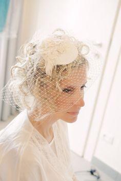 birdcage veil with flower piece #vintage #birdcageveil #weddingchicks http://www.weddingchicks.com/2014/01/22/lake-como-italian-wedding/