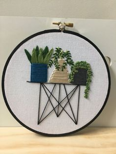 This trio of pots sits on a lovely wire table . A stitchy garden of succulents and cacti that would look lovely anywhere . All my work is hand stitched and designed by me in Tasmania. Feel free to contact me for any custom orders or ideas . Follow along on Instagram Im @moon_girl_stitches