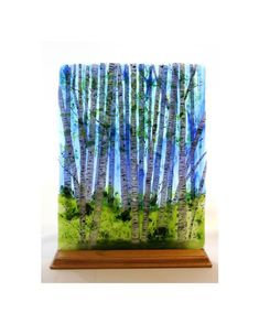"Summer Birch - The summer birch is achieved with multiple firings in the kiln.  The birch trees themselves are layered giving remarkable depth to the piece.  I  describe it as the birches being ""on the glass, in the glass and behind the glass.""  The technique to achieve this is both intensive and rewarding."