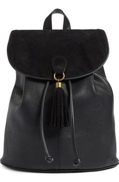 Featuring a chic velvet flap and tassel, this textured faux-leather pack looks like a million bucks but won't bust your bank account. A deep, lined interior, sturdy webbed straps and antiqued golden hardware complete the stylish look.
