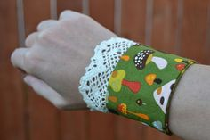 Mushrooms fabric cuff bracelet with crochet trim by mailebaldwin