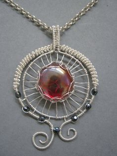 Red glass wire wrapped pendant by Wiredesignjewelry on Etsy, $44.95