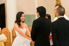 The bride grew teary holding the groom's hands and we can see how happy she is behind those tears.