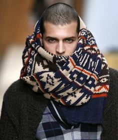The scarf is eating his face!!  LOL