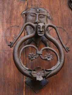 two faces in door knocker - photo taken in Spain by Doug Finney 2009_0341 | Flickr - Photo Sharing! forged