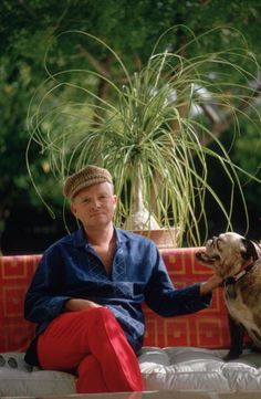 1970: Author of 'Breakfast at Tiffany's', Truman Capote (1924 - 1984) and his dog in Palm Springs, California.