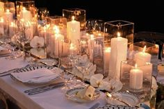 Romantic candles in rectangle hurricane vases make for a gorgeous centerpiece