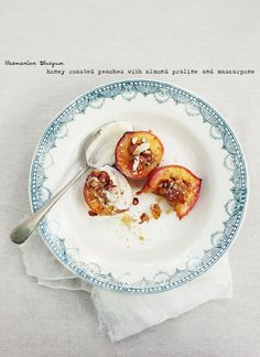 Honey Baked Peaches with Almond Praline and Mascarpone Cream