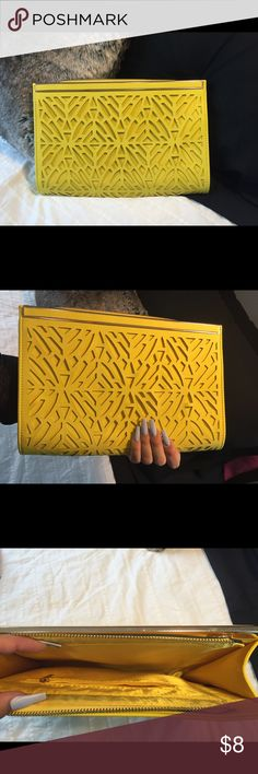 Large envelope clutch Large envelope clutch with gold hardware, good condition, used once or twice, bright yellow with plain back design on front shown Bags Clutches & Wristlets