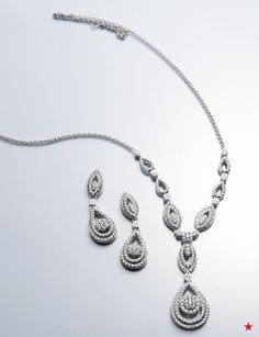 Perfect for a bridal gown with a sweetheart neckline, this diamond necklace and matching earrings ensure you will shine bright on your big day.