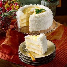 Nanny's Famous Coconut-Pineapple Cake Recipe Desserts with crushed pineapples in juice, butter, sugar, large eggs, lime, cake flour, lemon extract, vanilla extract, pineapple, cream cheese frosting, flaked coconut, fresh mint
