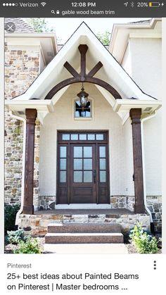 Image result for portico for 2 story white/black trim tudor house