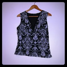 Dressy blouse/ sleeveless top Beautiful! Black and white damask print that is very flattering. The top has a black liner on the inside layer. Lined and ready to wear with a jacket for work or out for date night. new directions Tops