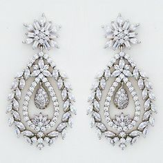 CZ Jewelry by Jascott. Spectacular CZ bridal chandelier earrings. Large pear drop features a leaf motif border lending a vintage vibe to these dazzlers.