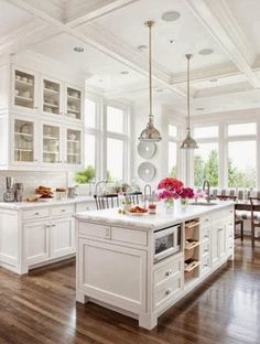 Light and airy while still homely :) would prefer butchers-block style work tops.