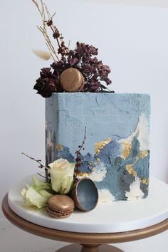 Dried and fresh flowers against a blue and grey buttercream cube cake. Luxury gold leaf detail and bronze macaron Creative Wedding Cakes, Beautiful Wedding Cakes, Wedding Cake Designs, Beautiful Cakes, Sugar Flowers, Fresh Flowers, Luxury Cake, Cake Flavors, Gold Leaf