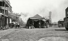 """Circa 1890s. """"The old French Market, New Orleans."""" Points of interest include many horsecars and an arc lamp on a boom. Ship Chandler's Grocer wagon and Deutsche Grocery at left. Photo by William Henry Jackson."""
