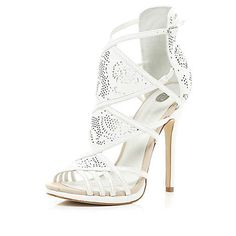 Love,love i could've bought the 3 colours :)  White laser cut high-vamp stiletto sandals £65.00
