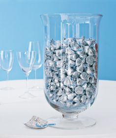 Christmas decor with kisses in a large footed vase look like silver bells