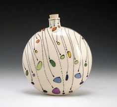 """Emily Free Wilson's signature style of Free Ceramics began in With the help of her husband, Matt Wilson, they worked together to fine-tune the pottery line of """"Dot Pots"""". Ceramic Clay, Ceramic Pottery, Pottery Art, Pottery Painting, Ceramic Painting, Bottle Art, Bottle Crafts, Keramik Vase, Ceramic Techniques"""
