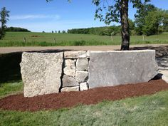 Unique stone wall for driveway entrance