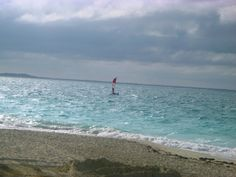 Windsurfing off of Grace Bay Beach. #OceanClub #TurquoiseWaters #Serene