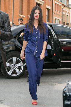 Selena is wearing a Derek Rose pajama set and Brian Atwood shoes