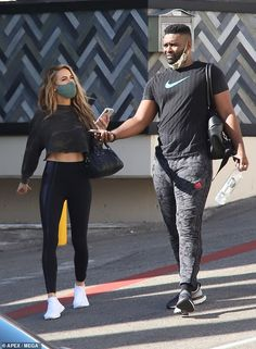 Wow factor: The 39-year-old Selling Sunset star flaunted her toned tum in a cropped camouflage sweater along with clinging black leggings and white sneakers Dwts Pros, Black Sparkly Dress, Buddy Workouts, Blue Face Mask, Partner Dance, Sweet Kisses, Grey Nikes, Just Friends, Dancing With The Stars