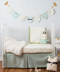 Every nursery can use a few more friendly faces keeping watch. This adorable 7 flag wall bunting comes with two terry cloth bows, embroidered rabbit, raccoon and fox animal pals, and some mountain peaks pattern panels. This nursery decor piece is 100% cotton canvas that is made sturdy so it will last until hand-me-down-day. A Hallmark Baby exclusive.