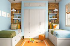 The Scotts' two older boys, Maxwell and Nolan, share the only room in the house without white walls. The soft blue (Pool by Serena & Lily), echoed in the bedding, providing a coastal-y contrast to the vibrant orange accessories. Built-in shelves behind the bed echo the wood paneling in the entryway and provide a spot for the boys to stash books, trophies, and other childhood treasures.