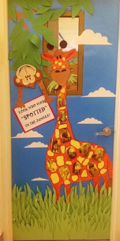 """Jungle/Giraffe classroom door. Giraffe's spots are children's pics printed on yellow paper in sepia tone. Monkey is a Dollar Tree paper plate with construction paper arms added to hold sign saying, Look Who Was """"SPOTTED"""" in the Jungle."""