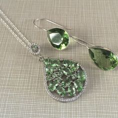 Green amethyst and white cz pndnt chain set 925 Both pendant and chain are stamped 925earrings are 1'1/4 long faceted stunningly beautiful green amethyst pendant is 1'3/4 long NWOT Jewelry Necklaces