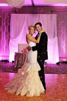 Wedding Day Bubbles with pink unplighting - Our DJ Rocks. Photo credit: Heather Rice Photography #Ourdjrocks #weddingbubbles #pinkuplighting