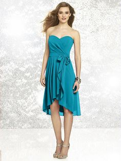 Strapless nu-georgette dress with wrap bodice and sweetheart neckline. Faux wrap skirt and hi-lo hem. matching nu-georgette sash at natural waist.   http://www.dessy.com/dresses/bridesmaid/8131/