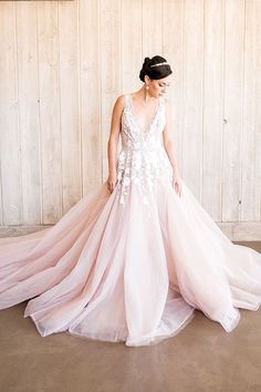 Stunning Modern Ball Gown in Blush with Floral Embroidery | http://heyweddinglady.com/styling-modern-bridal-tiara-blush-wedding-dress/