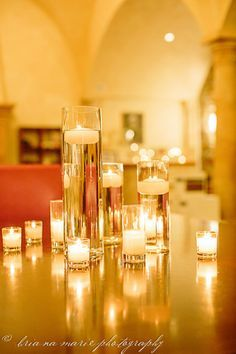 DIY wedding decor: Tall cylinder vases, filled with water, topped with floating candles. Gives off warm and inviting light. Creates welcoming atmosphere. (Provides entertainment for all your pyromaniac friends ;) | best stuff