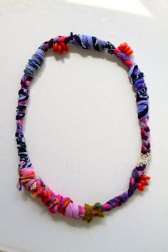 This necklace is made with hand dyed upcycled cotton that has been braided, twisted, knotted, and accented with red coral, vintage lace, and other rescued fabric. Stretches over the head - 26 inches