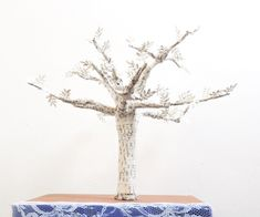 This tutorial will show you the steps involved in making a 3D tree sculpture from wire and paper. It takes a while but can be completed in a weekend, including the time needed for glue to dry.What you will need:- Book pages; Using pages from a book looks especially effective, but you can use other types of paper if you prefer. I didn't count how many I used for this tree but I doubt it was more than 15.- Wire; Look for wire that is labelled as modelling wire or armature wire. I used 1.6mm...