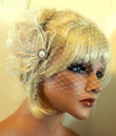 Not sure what you do with the veil after the ceremony... do you take it off? Leave it on? Lift it up? Since it is a bandeau that attaches on both sides... rather hard. Ivory Fascinator with bandeau Bridal Veil Pearl by kathyjohnson3, $72.00