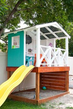 Learn how to build a wooden outdoor playhouse for the kids. This DIY playhouse has it all: sandbox, climbing wall, slide and clubhouse! Housefulofhandmade.com #outdoorplayhouseideas