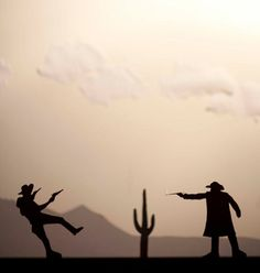 What It Is: Cowboy Silhouette fight  Why I Like It: I think that the positioning of the camera is in a good spot, as it enables the audience to see both actions of each character. Additionally, it relates to the genre of 'western' i.e. classic western shoot out