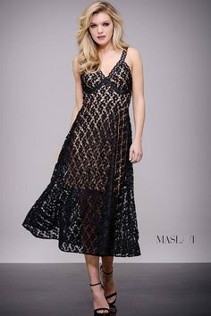 On trend black tea length empire waist lace dress with nude underlay features sleeveless bodice with v neckline.