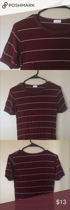Maroon Striped Brandy Melville Tee Super comfy maroon & white striped tee that I purchased at Brandy Melville! The brand is j.galt. Barely worn, great condition! Super soft & stretchy material. Would look great tucked into a pair of high waisted shorts! Brandy Melville Tops Tees - Short Sleeve