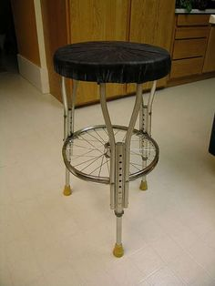 http://www.instructables.com/id/Stool-made-from-bike-parts-and-crutches/