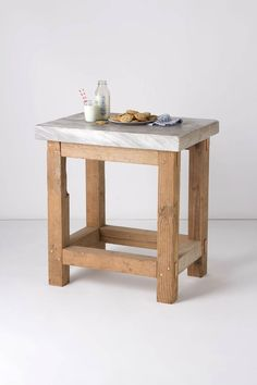 "Both an extra counter space and a piece of history, this sturdy pinewood structure is topped with a thick slab of marble, repurposed from our hometown of Philadelphia's Independence Mall. Designed by Robert Ogden of Lostine. - Natural finish - Marble, pine wood - 36""H, 33.5""W, 24.5""D - Handcrafted in USAAn additional $150 will be added for oversize shipping and in-home delivery. Please allow 3-4 weeks for delivery. This item is only available for delivery within the continental United States...."