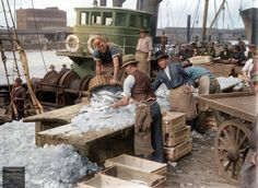 Wholesale fish merchants J.R. Borrett & Co. unloading and processing fish at Queen's Wharf on the Yarra River, Melbourne, behind the Fish Market building which was located on the south east corner of Flinders Street and Spencer Street, circa 1940.