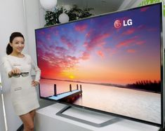 LG unveils 84-inch 'ultra definition' 4K TV (120Hz) - don't look at the girl, look at the screen ;).  Some tags:  #lgscreens #lgtv